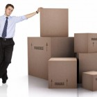 business man with packed cardboard boxes over a white background